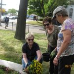 Maintaining the garden at the Norwalk Public Library.